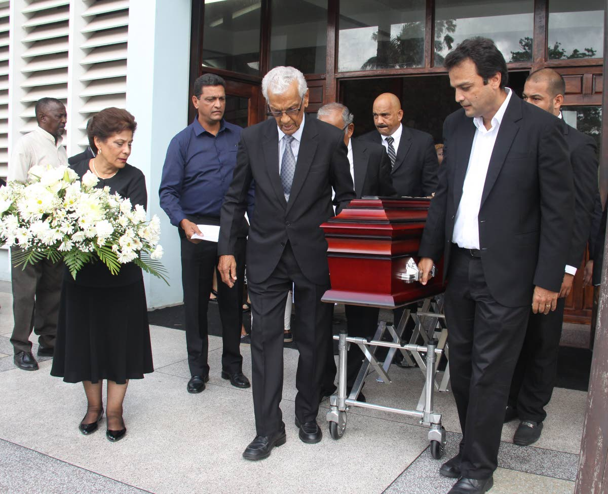 Relatives of June Gonzalves, carry her casket yesterday at her funeral service, Church of Assumption, Maraval. PHOTO BY ANGELO M MARCELLE