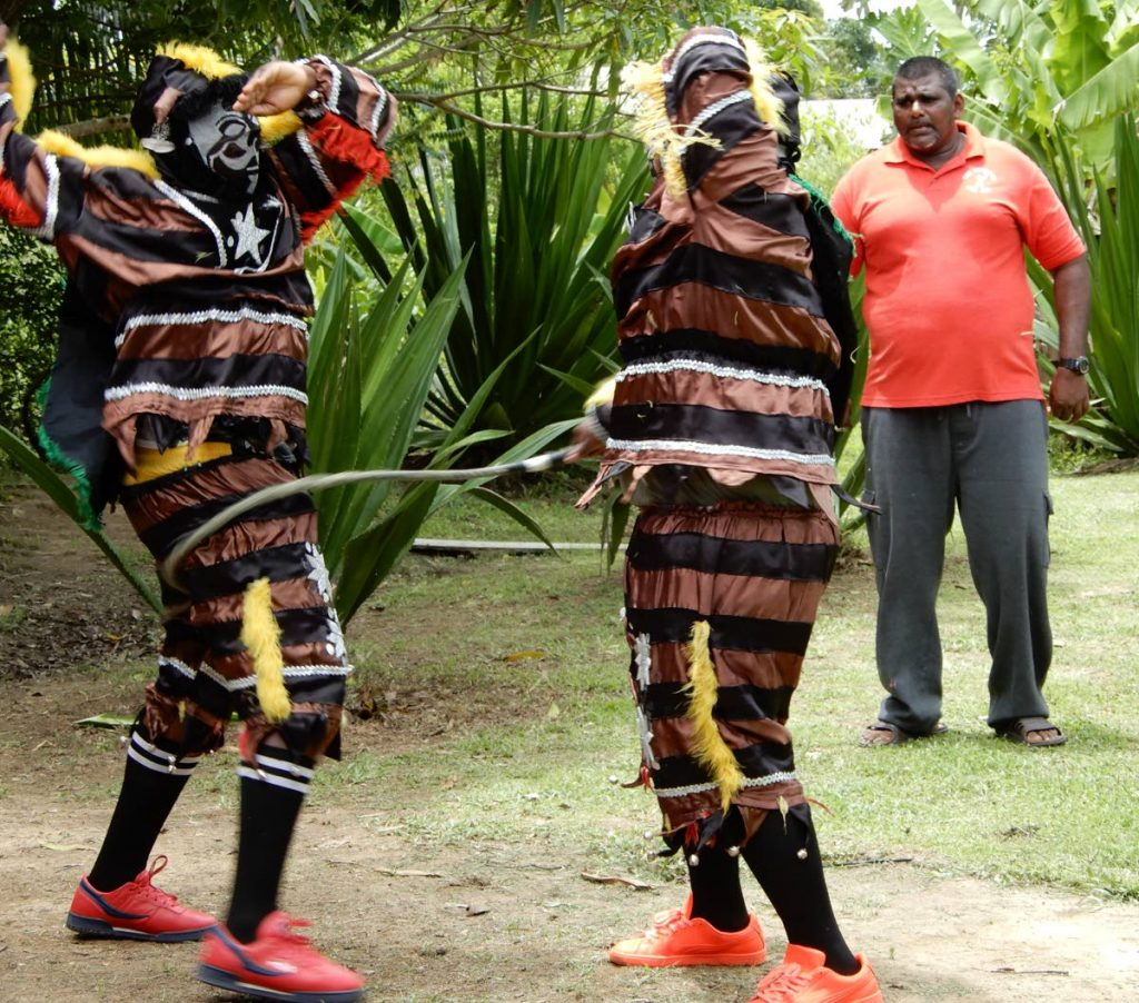 Jab jabs whip each other at Whipmaster Avenue, Balmain, Couva under the supervision of Ronald Alfred during a visit by members of the Eastern Horticultural Club in July. PHOTOS COURTESY THE EASTERN HORTICULTURAL CLUB