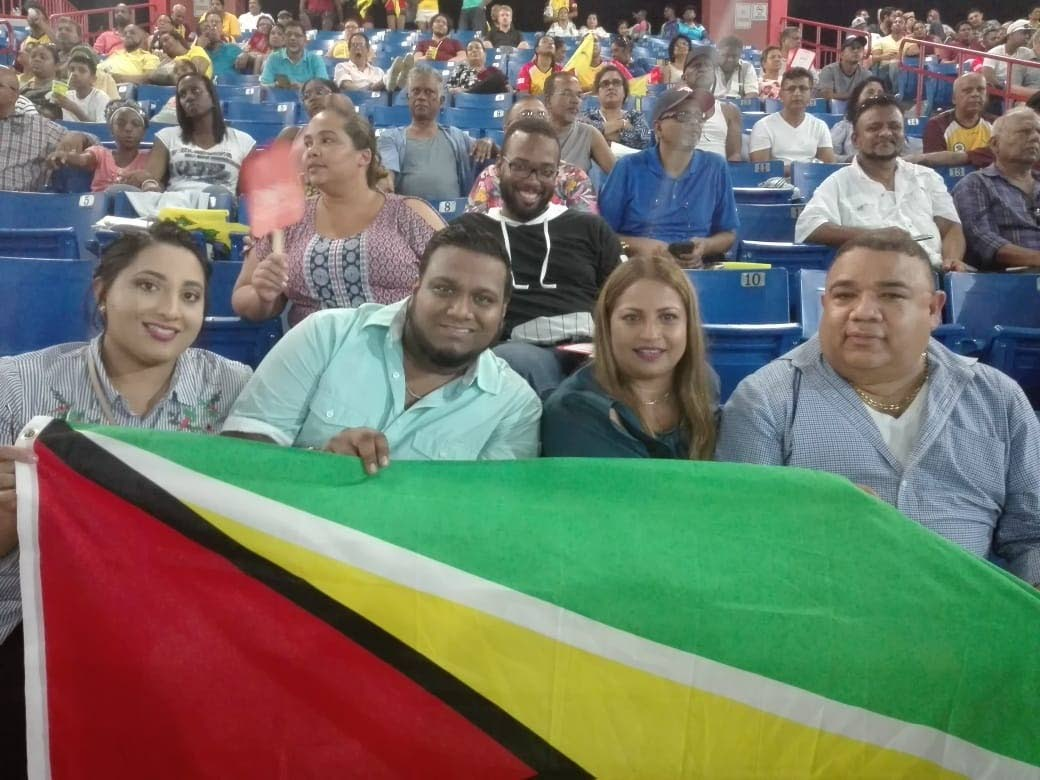 PAUL DaSilva,right, former president of the Nassau New York Cricket Assocition and members of his family enjoy a night of cricket at the Central Broward Regional Pak and Stadium, Ft Lauderdale, on Saturday, as the Guyana Warrior took on the Jamaican Tallawahs.
