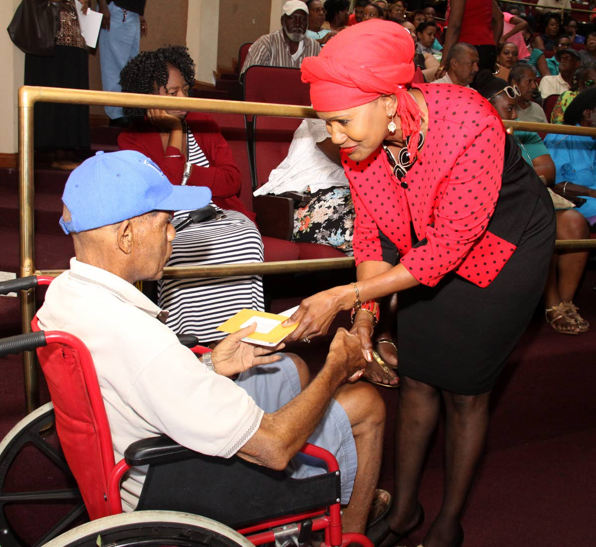 A former URP worker receives his URP cheque from Minister of Labour and Small Enterprise Development, Jennifer Baptiste-Primus.