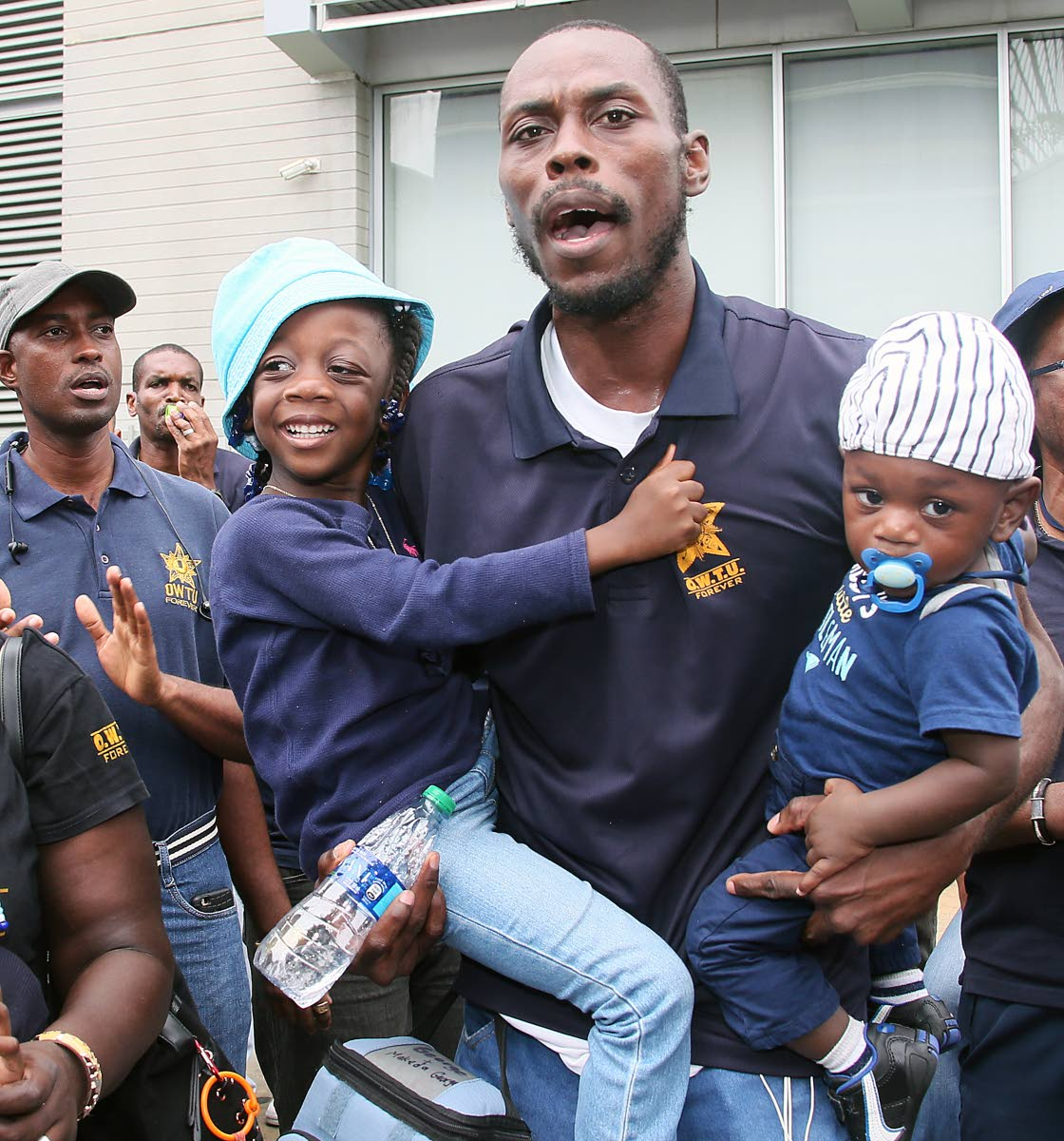Support for Daddy: OWTU member Daniel George got full support from his children, Makeda and Micah, as union members led by president Ancel Roget gathered outside the Office of the Prime Minister, St Clair. PHOTO BY AZLAN MOHAMMED