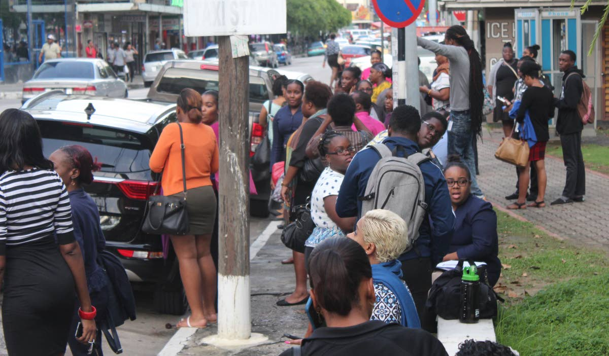 People gather at the Brian Lara Promenade - a muster point for several businesses in Port of Spain - after Tuesday's eartquake.