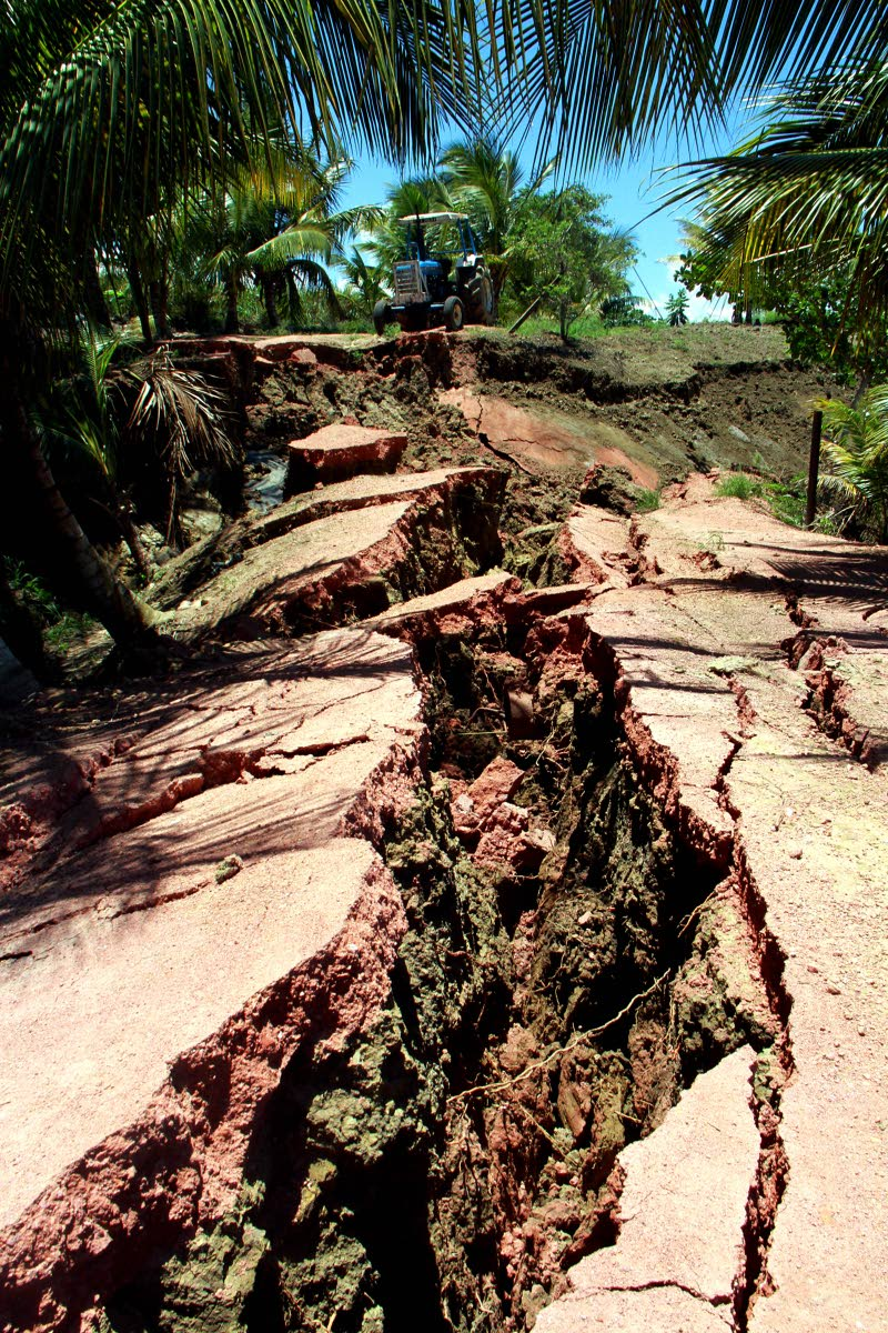 Huge cracks on the Los Iros Hillview Road after the earthquake. PHOTO BY ANIL RAMPERSAD.