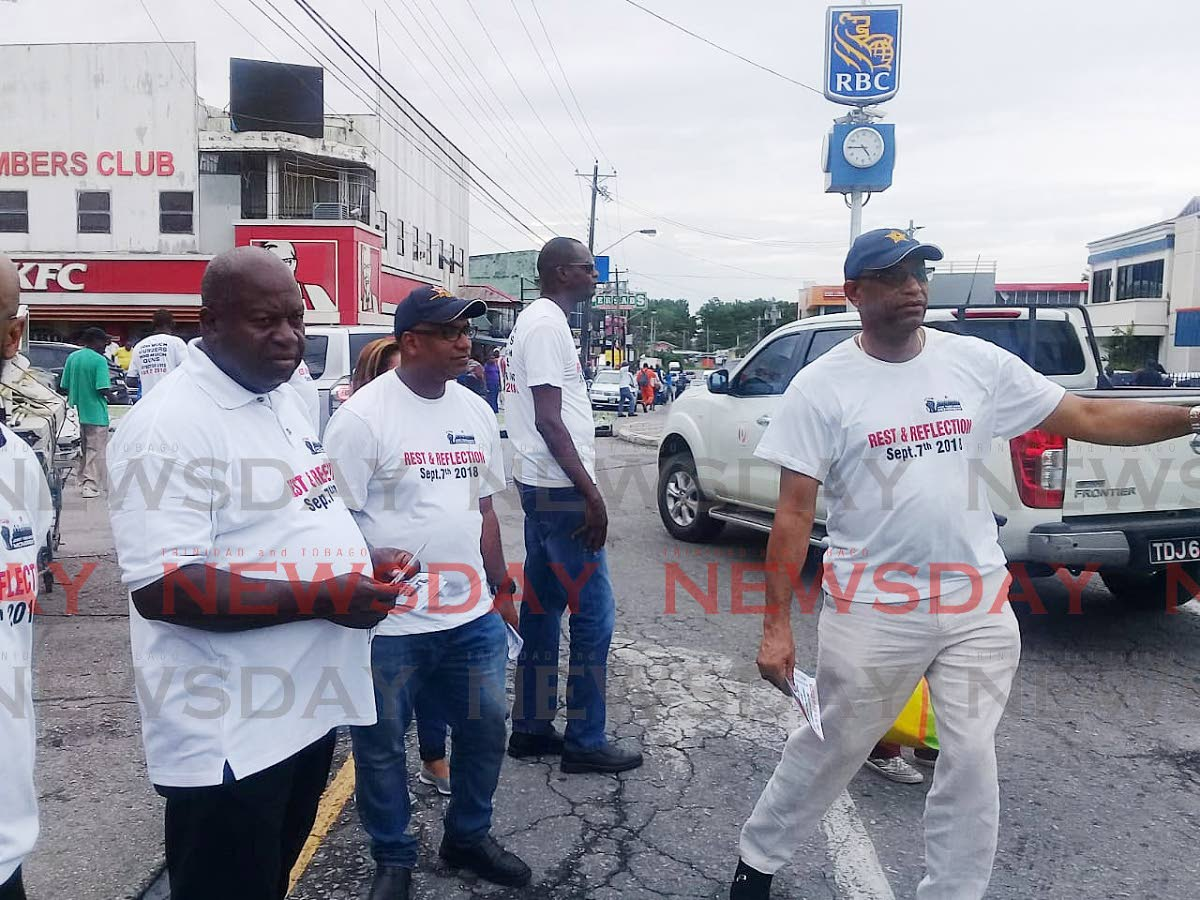 Join us: OWTU president general Ancel Roget and his team hands out flies in Point Fortin last Friday, calling on the public to take part in the day of rest and reflection on September 7. PHOTO BY SEETA PERSAD