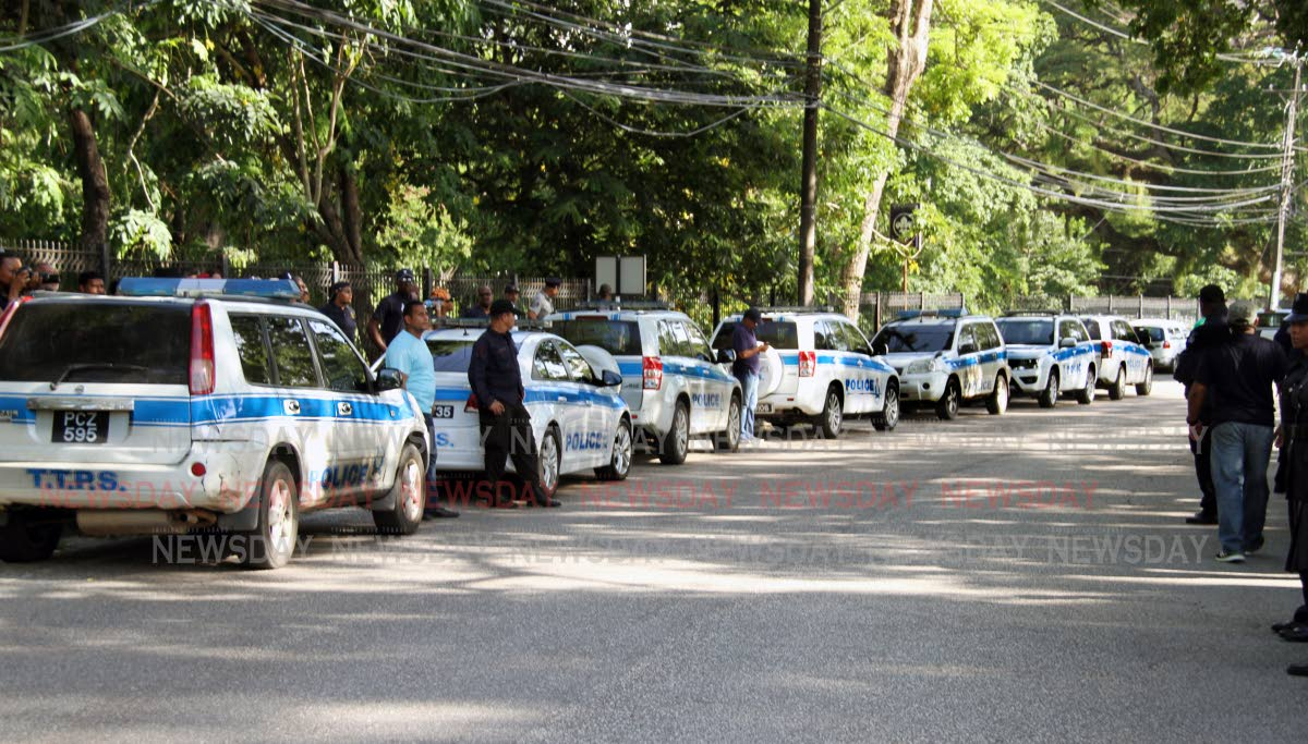 More than a dozen police vehicles outside  Prime Minister's Residence at La Fantasie Road in St Ann's yesterday during the OWTU evening of prayers.