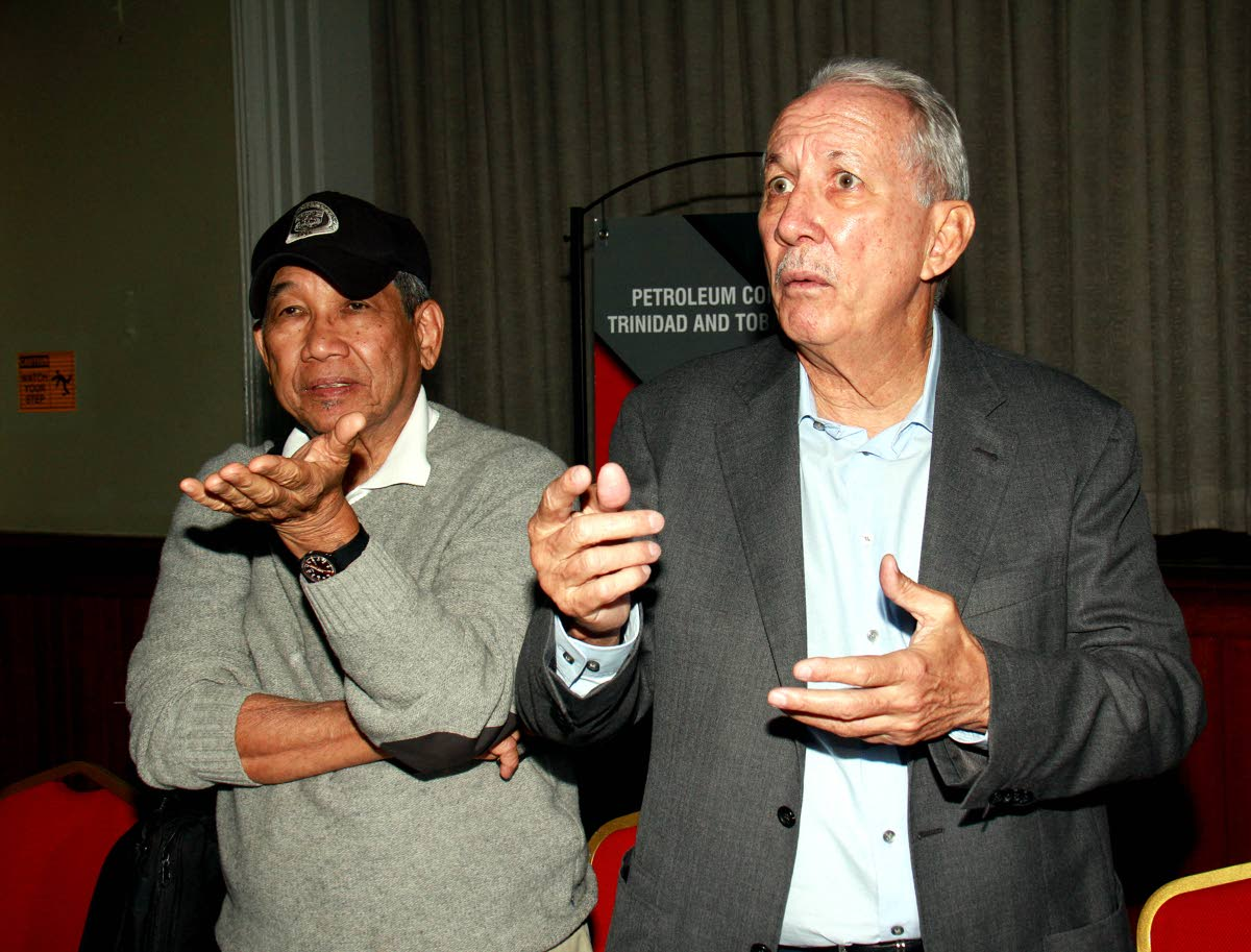 THAT'S IT: Petrotrin chairman Wilfred Espinet (right) and executive director -Refinery/Marketing Anthony Chan Tack at yesterday's press conference at the company's staff club in Point-a-Pierre.
