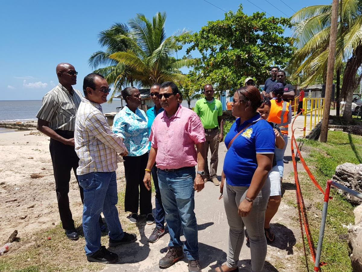 Flashback: In this August 18 file photo, Cedros councillor Shankar Teelucksingh, left, talks with Works Minister Rohan Sinanan at the flood gates in Bonasse Village Cedros during a tour of projects in Point Fortin and La Brea. Teelucksingh yesterday called on the Health Ministry to give details of its findings that malaria tests done on 50 people were negative. FILE PHOTO