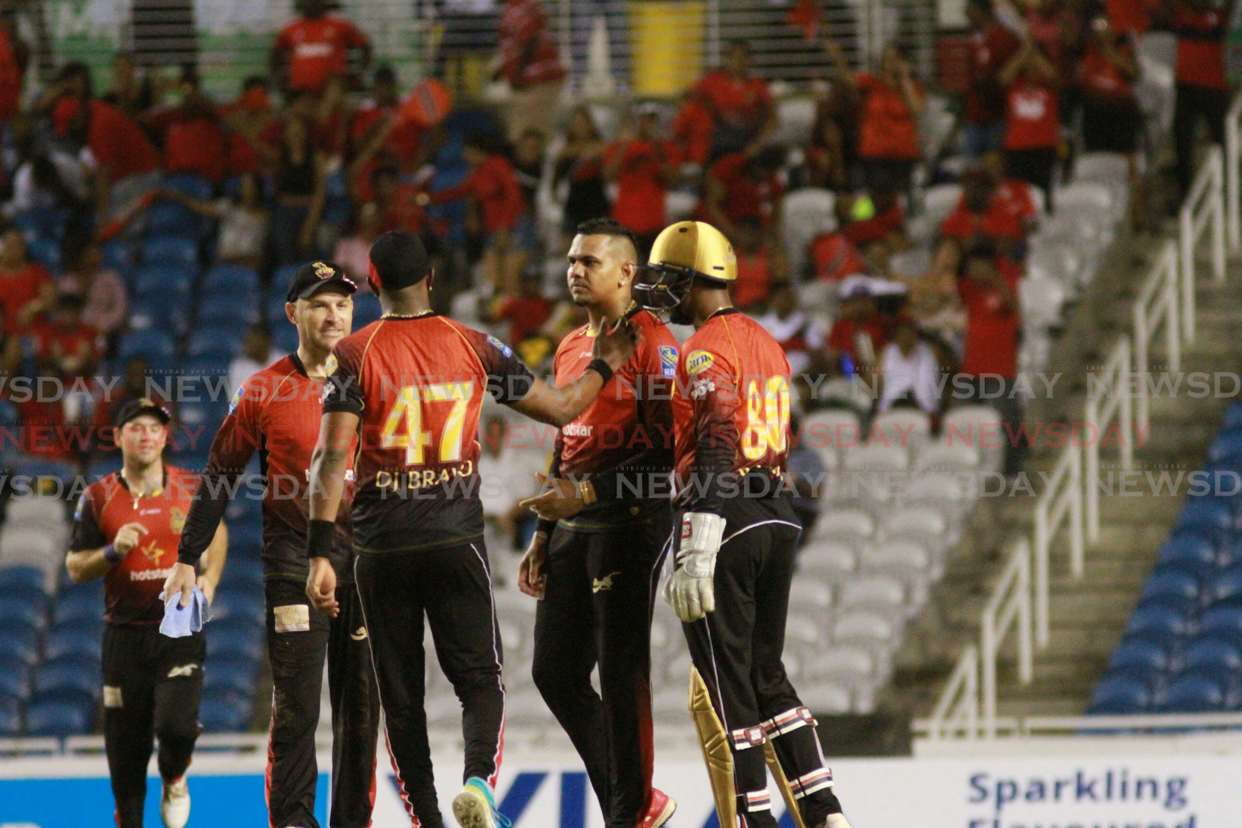 Trinbago Knight Riders celebrate after Sunil Narine (second from right) takes a wicket in the semifinals of the Caribbean Premiere League. Photo by Anil Rampersad