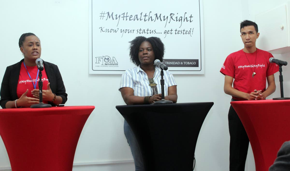 SPEAKING OUT: Khadija Pierre, Kimberly Gilbert and Kevin Lee a-Ping at De Living Room on Wednesday, discuss reproductive health and the Family Planning Association.