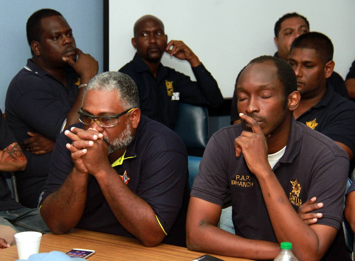 OWTU members and employees of the refinery in a sombre mood during a press conferene at OWTU headquarters, San Fernando last Thursday. PHOTO BY ANIL RAMPERSAD.