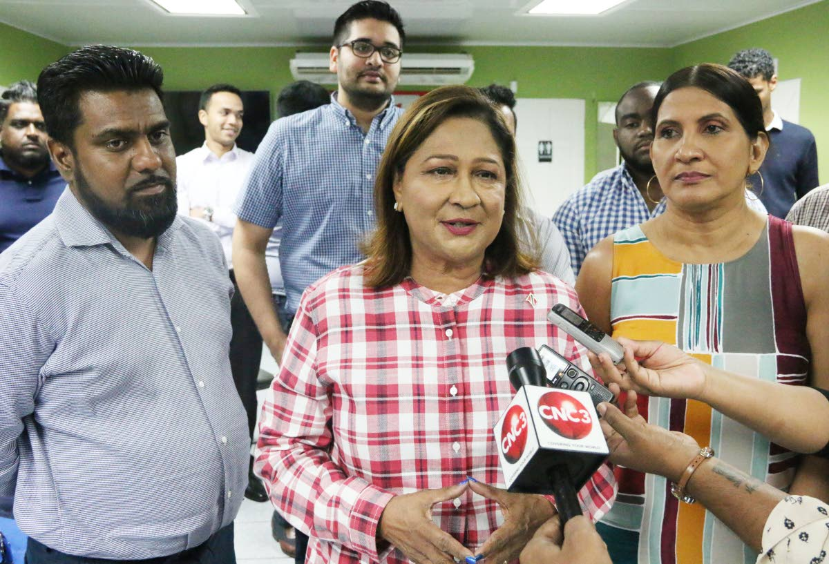 Save the refinery: Opposition Leader Kamla Persad-Bissessar speaks to the media at her constituency office in Penal yesterday. Persad-Bissessar urged the Prime Minister to reconsider closing down Petrotrin's refinery. PHOTO BY ANSEL JEBODH