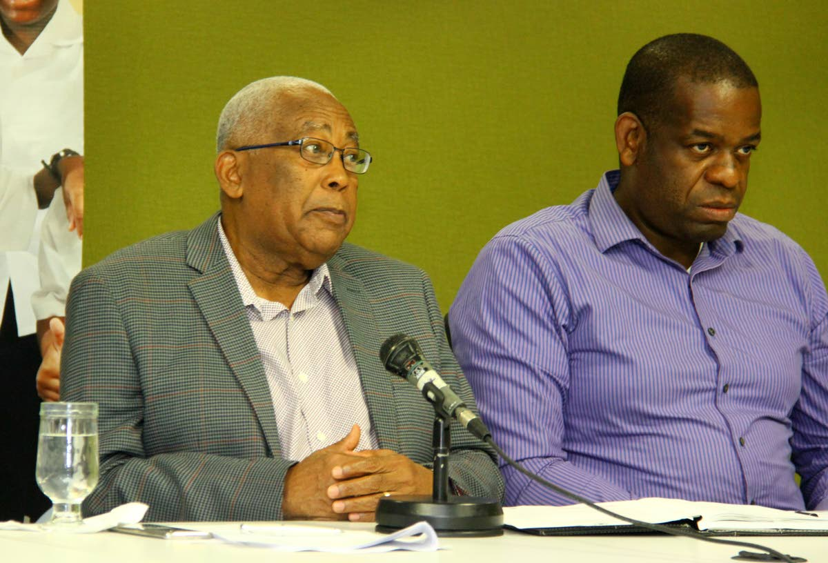 TOUGH LESSON: Education Minister Anthony Garcia and Dr Lovell Francis, Minister in the Education  Ministry, update the media at the ministry, St Vincent Street, Port of Spain yesterday, on the reopening  of schools tomorrow. Four schools will remain closed because of damage due to the 6.9 earthquake  on August 21. PHOTO BY ROGER JACOB