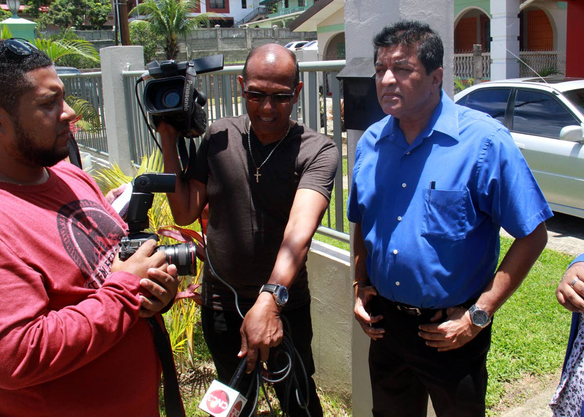 Fyzabad MP Dr Lackram Bodoe speaks with members of the media in front the home of Fyzabad businessman Anderson Kokaram who was shot and killed inside his bedroom on Saturday.