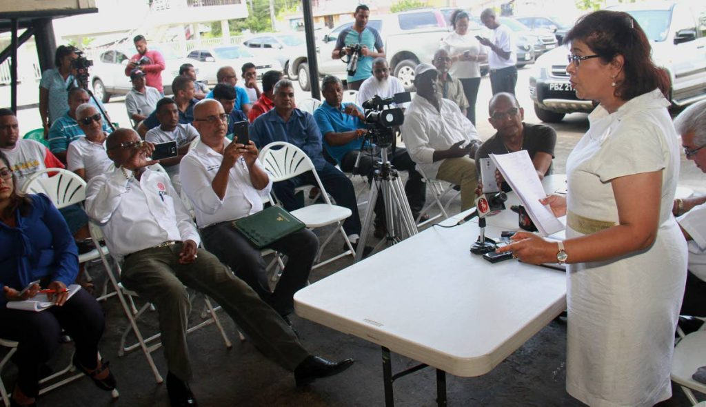 COP leader Carolyn Seepersad-Bachan addresses some of the workers who will be affected by the closure of the Petrotrin refinery, at Clarke Road in Penal yesterday.