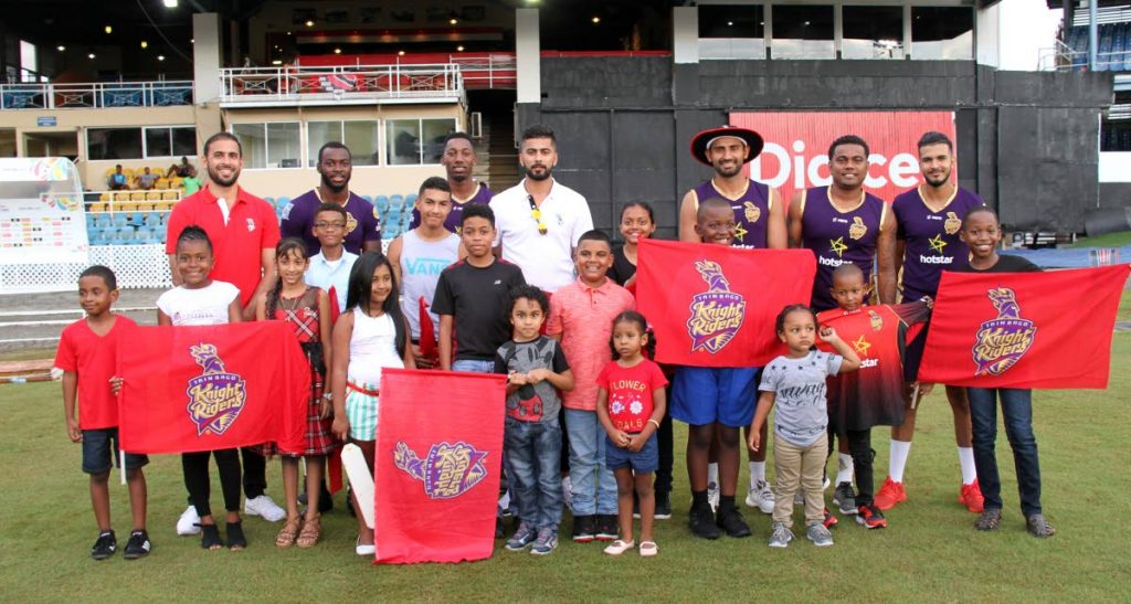 Children that took part in the Newsday Kids Fan-tastic CPL Cricket promotion get a chance to meet and greet TKR players at the Queen's Park Oval, St Clair, yesterday.