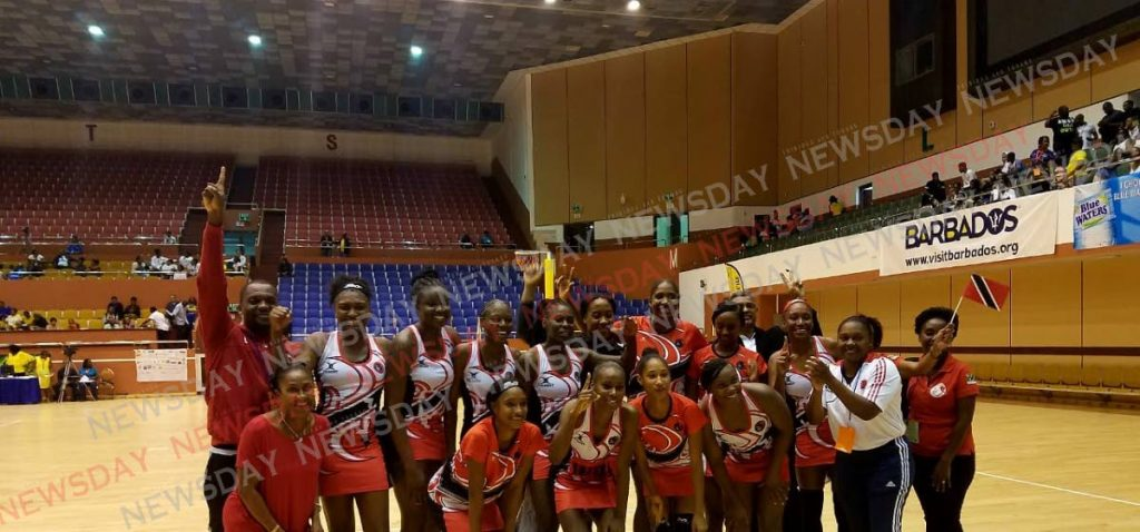 The Calypso Girls celebrate victory at the Americas Netball Federation Association Championships in Barbados on Sunday. PHOTO BY SHERDON PIERRE