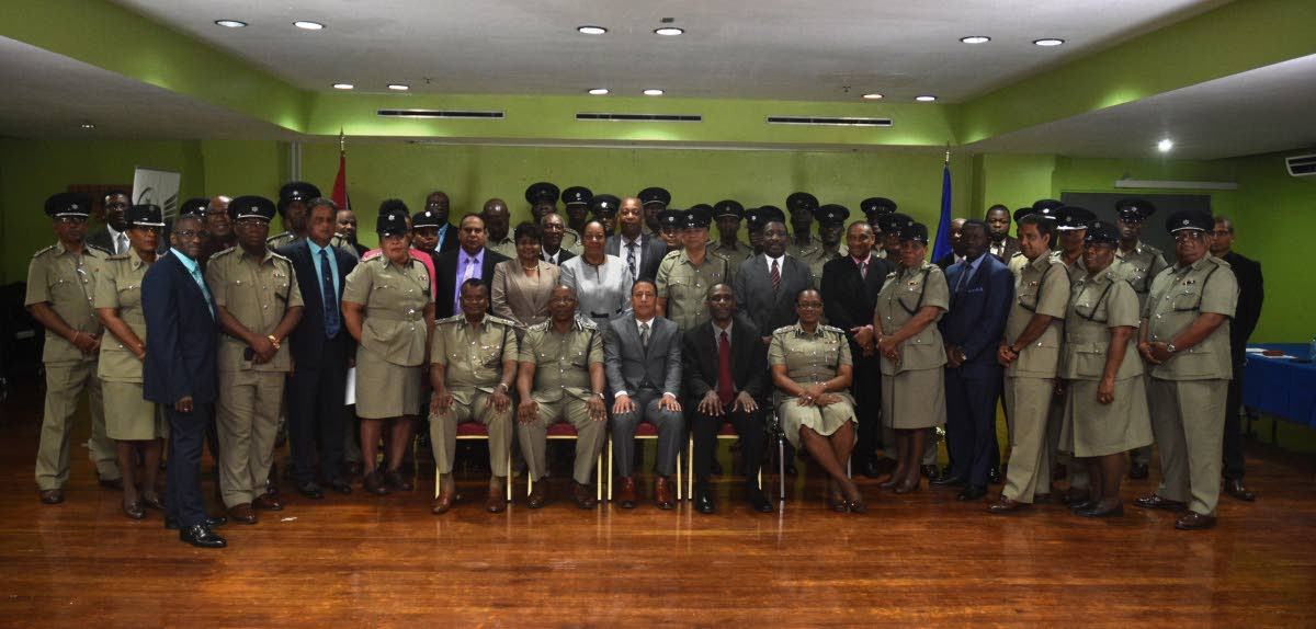Commissioner of Police, Gary Griffith, seated at centre along with (R) Deputy Commissioner of Police, Administration, Stephen Williams, Deputy Commissioner of Police (Ag.) Operations, Deodat Dulalchan, while to the left, Deputy Commissioner of Police (Ag.) Crime and Support, Harold Phillip and Assistant Commissioner of Police, Erla Christopher, are photographed with newly promoted officers to the ranks of Senior Superintendent of Police and Superintendent of Police, at the Solomon McLeod Lecture Theatre, Police Administration Building, Port of Spain, on Tuesday 4th September, 2018. Photo courtesy TTPS