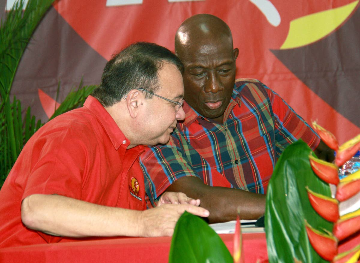 SERIOUS BUSINESS: Minister of Energy and Energy Affairs, Franklin  Khan and Prime MInister Dr Keith Rowley at a public meeting held at the Marabella Community facility.