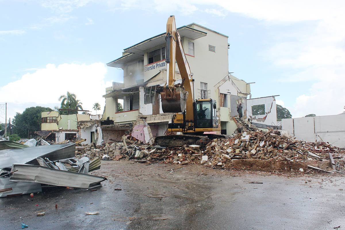 GOING DOWN: A Caterpillar crane demolishes the site of the Ellerslie Private Hospital, St Clair and the former site of Stanley's Nursing Home.