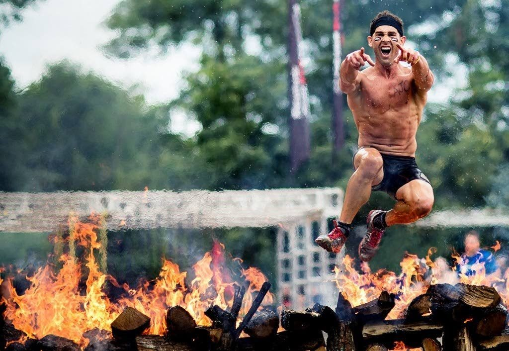 A competitor leaps past a fire obstacle at a previous edition of Spartan Race.