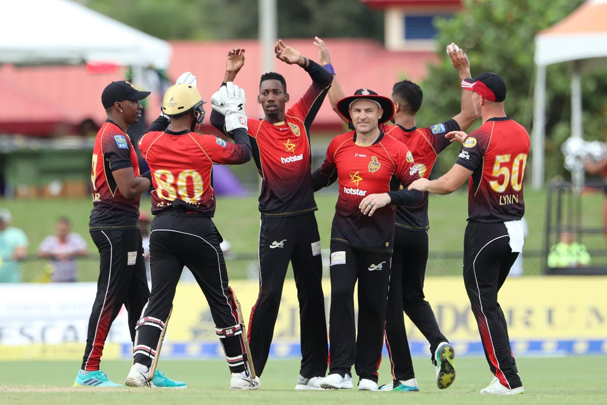 Trinbago Knight Riders spinner Khary Pierre, centre, celebrates a wicket during a Hero Caribbean Premier League match vs Jamaica Tallawahs earlier this season. PHOTO BY CPL T20