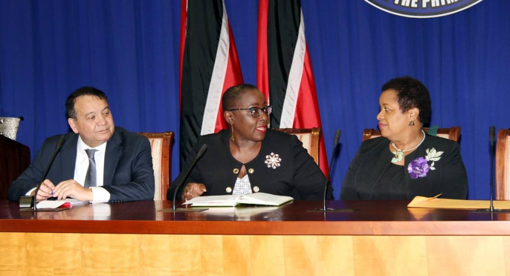 NOT BUDGING: Energy Minister Franklin Khan, Planning and Development Minister Camille Robinson-Regis and Minister in the ministry of Finance Allyson West at yesterday's news conference after a meeting between government and union leaders at the Office of the Prime Minister in St Clair. PHOTO BY SUREASH CHOLAI