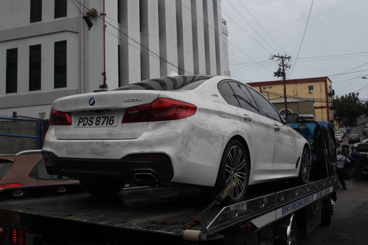 CRIME EXHIBIT: Natalie Pollonais' car is taken to the Police Administration Building in San Fernando yesterday.