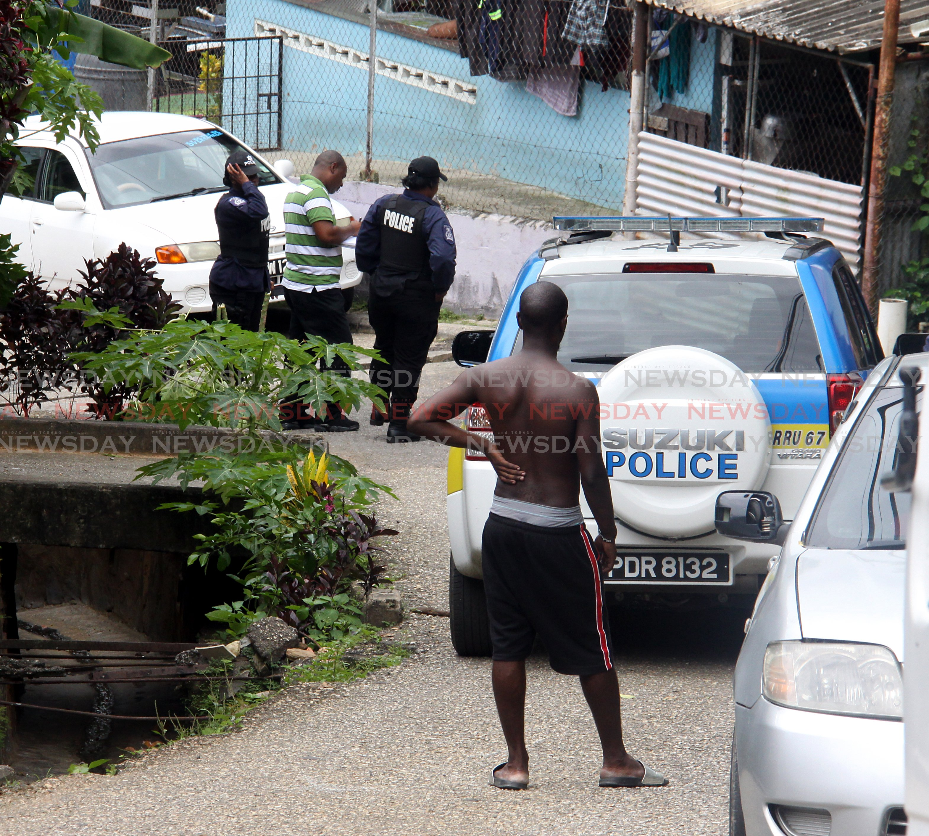 A man looks on as police investigates a triple murder, La Canoa, Santa Cruz.  PHOTO:ANGELO M. MARCELLE 08-09-2019
