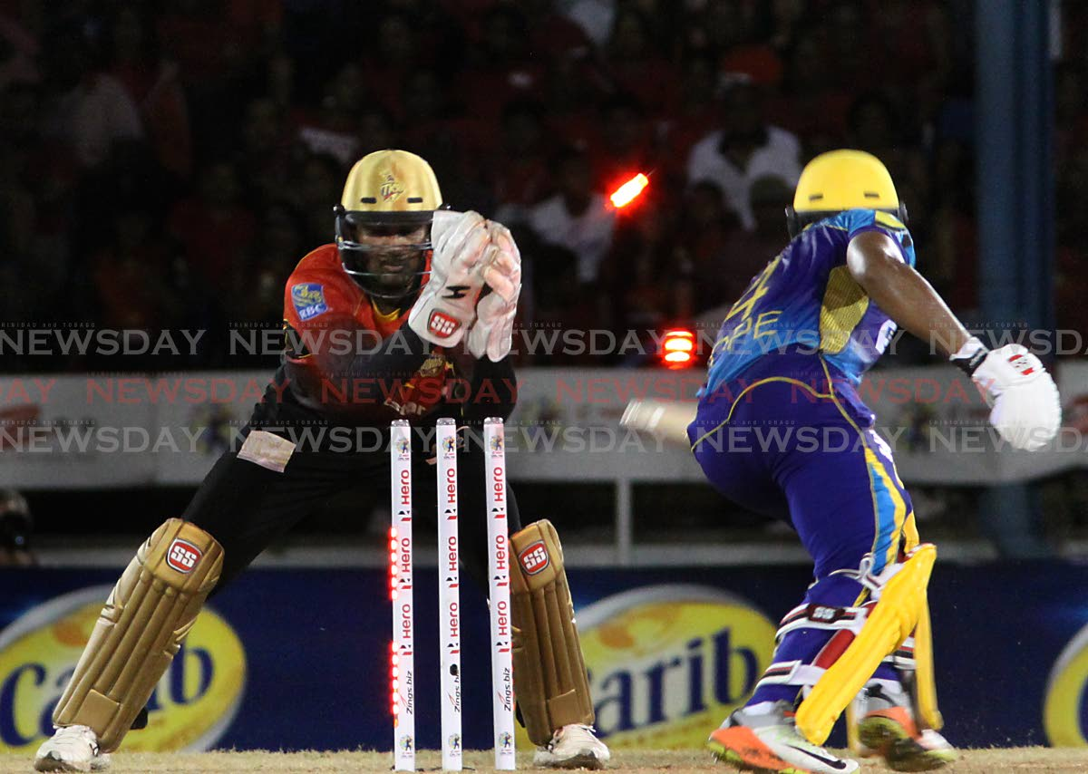 QUICK HANDS: Trinbago Knight Riders wicketkeeper Denesh Ramdin stumps out Barbados Tridents' Shai Hope during the Hero Caribbean Premier League game in 2018 at the Queen's Park Oval, St Clair.