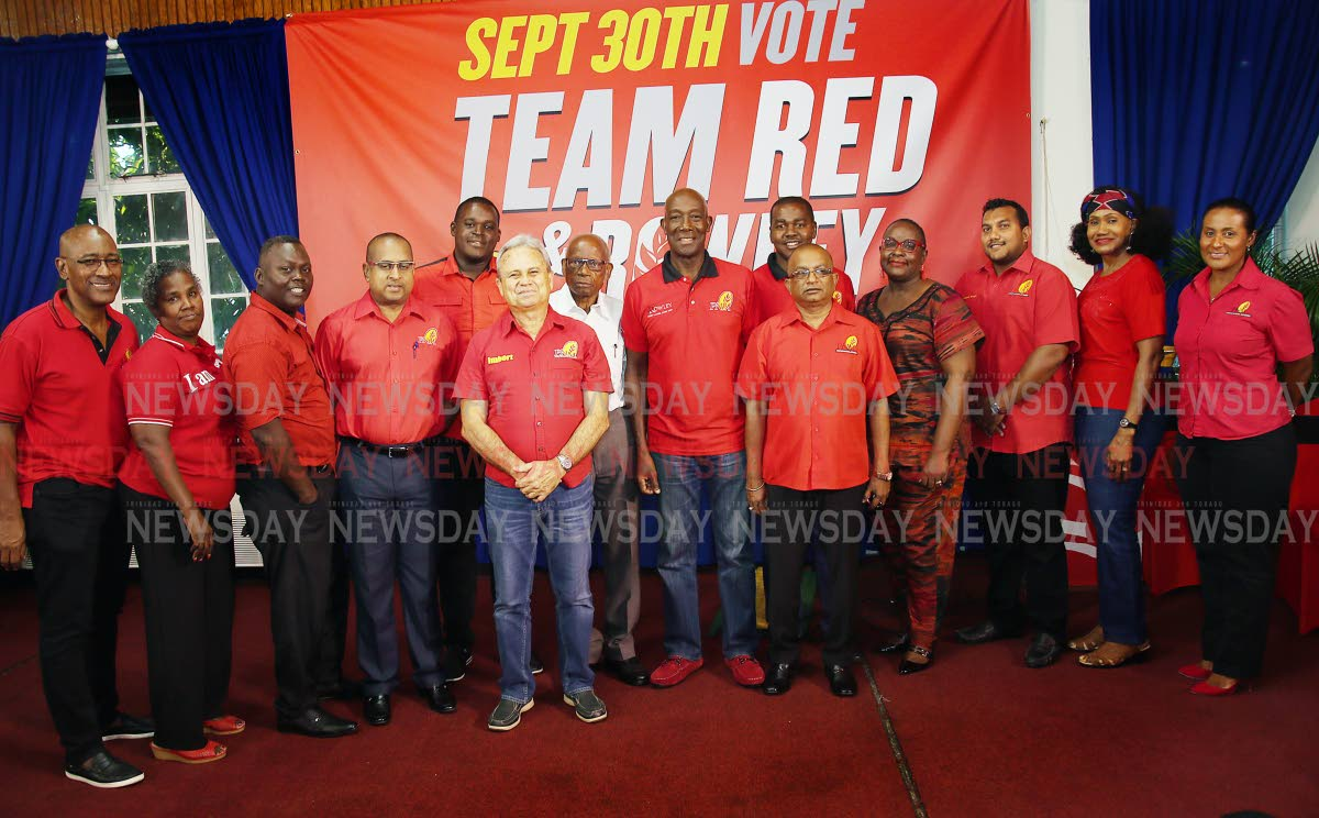 Rowley's team: Prime Minister Dr Keith Rowley, centre, with his slate of candidates for the PNM internal election, from left, Robert Le Hunte, Irene Hinds, Abdon Mason, Daniel Dookie, Ndale Young, Finance Minister Colm Imbert, Overand Padmore, Foster Cummings, Indar Parasram, Planning and Development Minister Camille Robinson-Regis, Avinash Singh, Labour Minister Jennifer Baptiste-Primus and Laurel Lezama at the Arima Town Hall, Arima yesterday. PHOTO BY AZLAN MOHAMMED