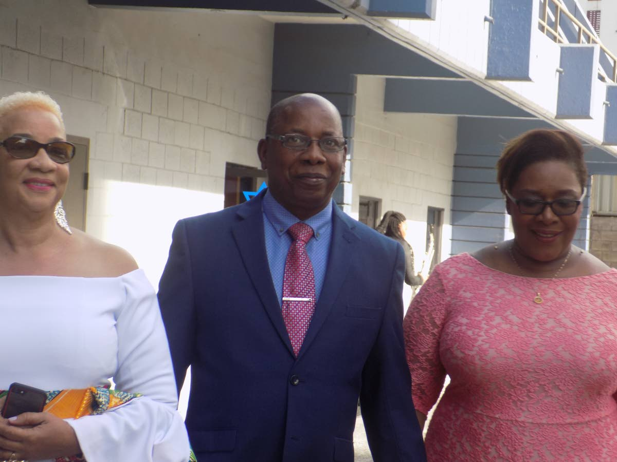 FIX YOUNG PEOPLE: Former acting police commissioner Stephen Williams, centre walks alongside his wife Avason Quinlan-Williams, right and secretary general of the police service retiree's association Julie Carrington outside Riverside Plaza in Port of Spain Sunday.