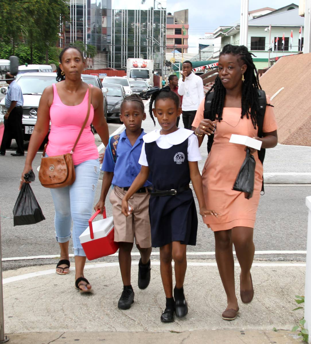 Parents of pupils of Tranquillity Government Primary School in Port of Spain take their kids home earyly after a  disruption in their pipe borne water supply, that this is due to a ruptured WASA 36-inch diameter transmission main, along the Beetham Highway, which occurred on Sunday.PHOTO SUREASH CHOLAI