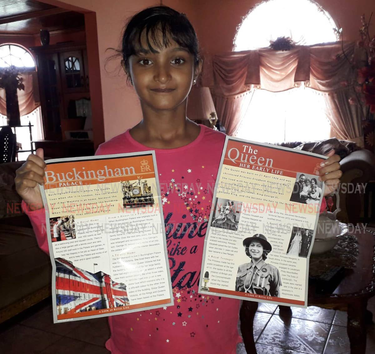 Anisha Rampersad, nine, displays two brochures sent to her by Queen Elizabeth 11, of Buckingham Palace. PHOTO BY ANIL RAMPERSAD.