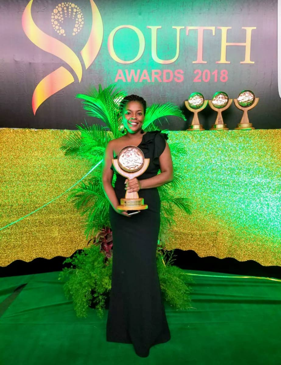 Rheanne Moore, leader of the Charlotteville Police Youth Club, poses with her National Youth Award for Leadership and Advocacy at the Hyatt Regency in Trinidad last Saturday.
