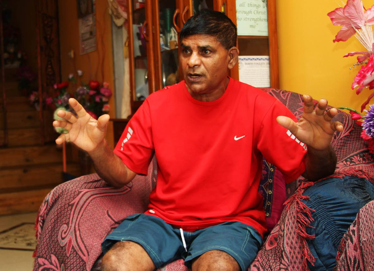 GARY, HELP US: Frankie Rajkumar, father of Ria Sookdeo who was kidnapped almost two years ago, speaks at the family's home yesterday.