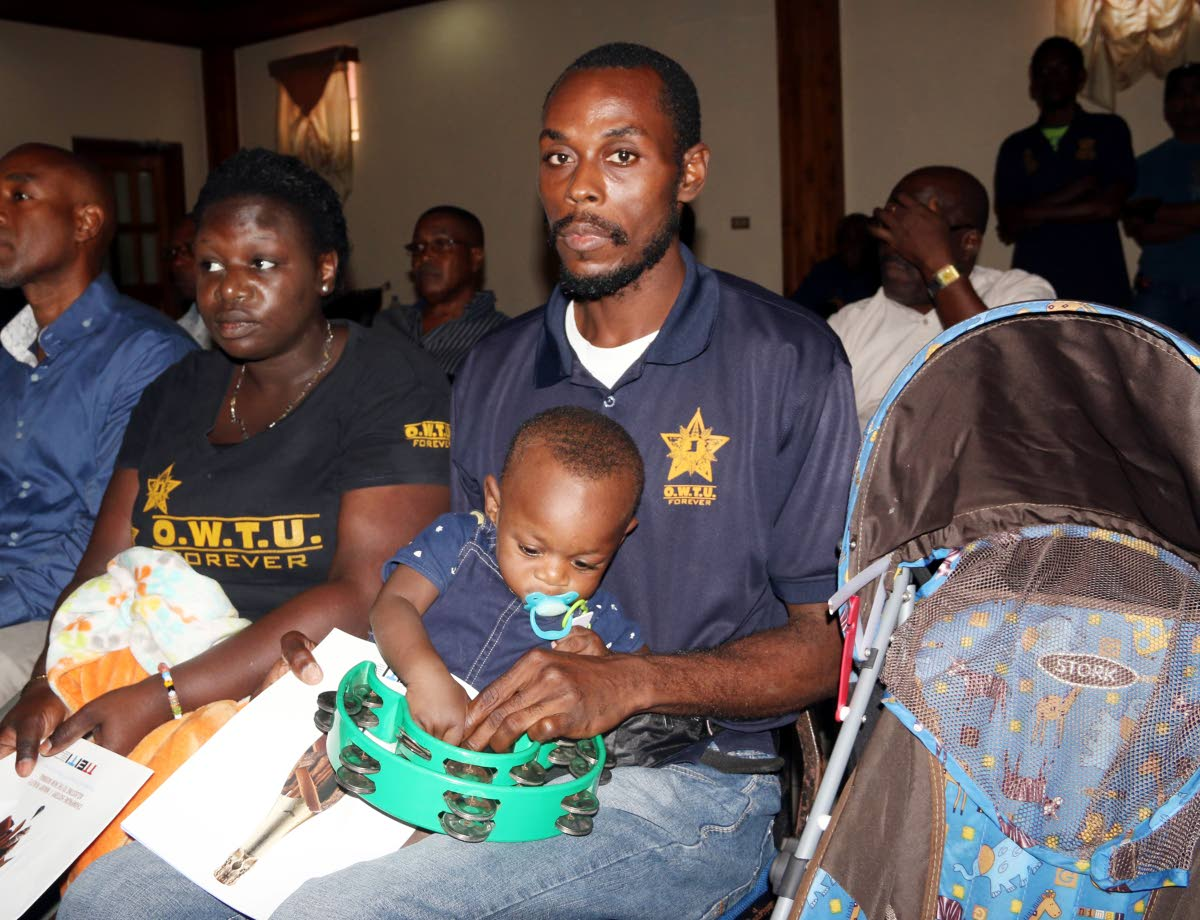 Daniel George and his wife Penni with their son Micah, 11 months, at the forum hosted by the Lloyd Best Institute at City Hall, San Fernando.
