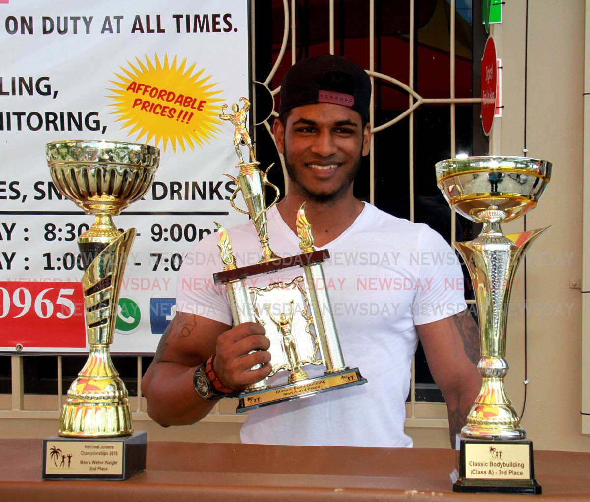 Doublesman Rasheed Ali of Rio Claro shows off his trophies after entering several  body building competitions  PHOTO BY ANIL RAMPERSAD.