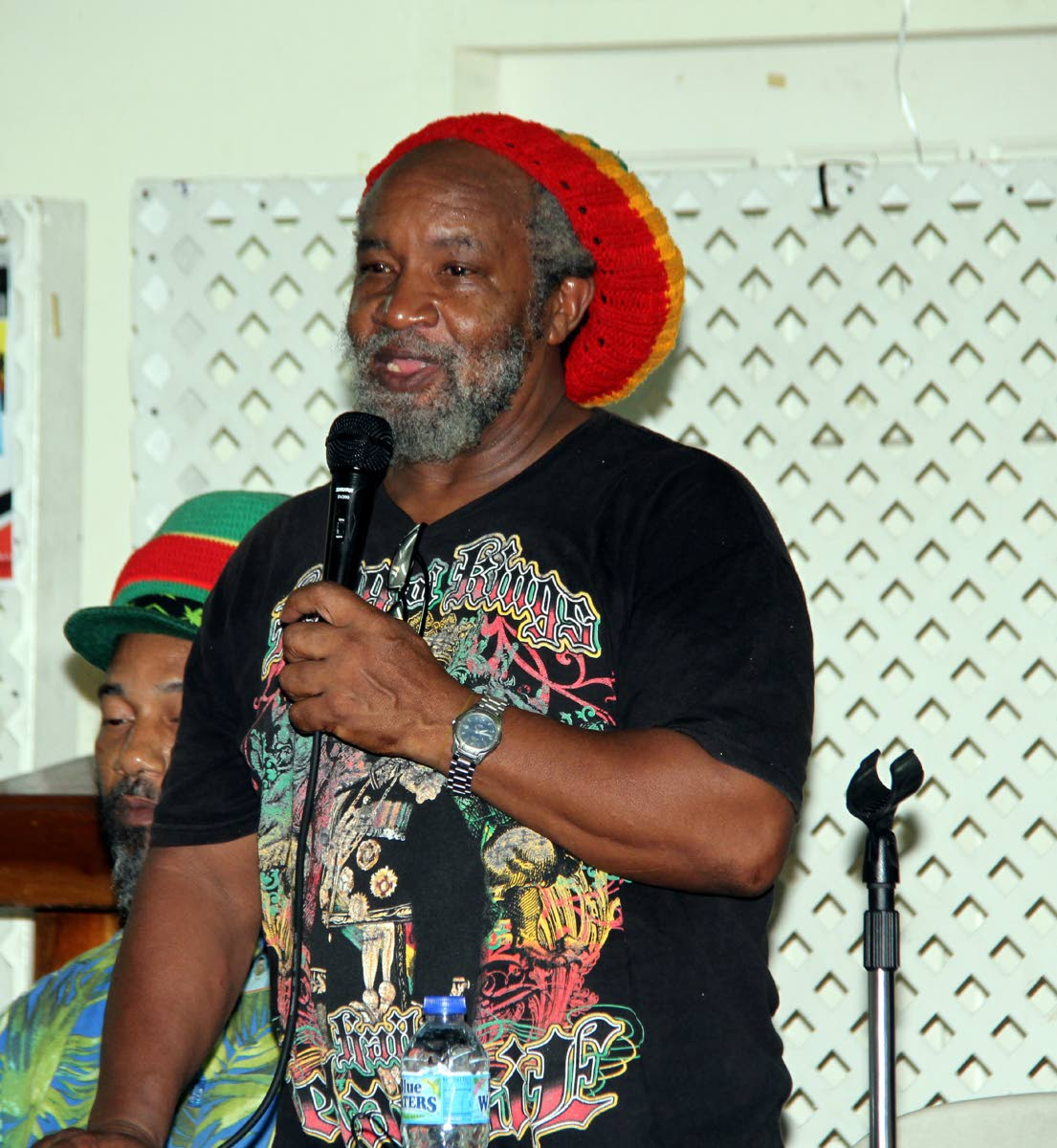 LEGALISE IT: Clyde Noel, represenative of All Mansions of Rastafari, speaks during a symposium on the legalisation of marijuana held on Thursday night at the Communication Workers Union headquarters, Henry Street, Port of Spain.
