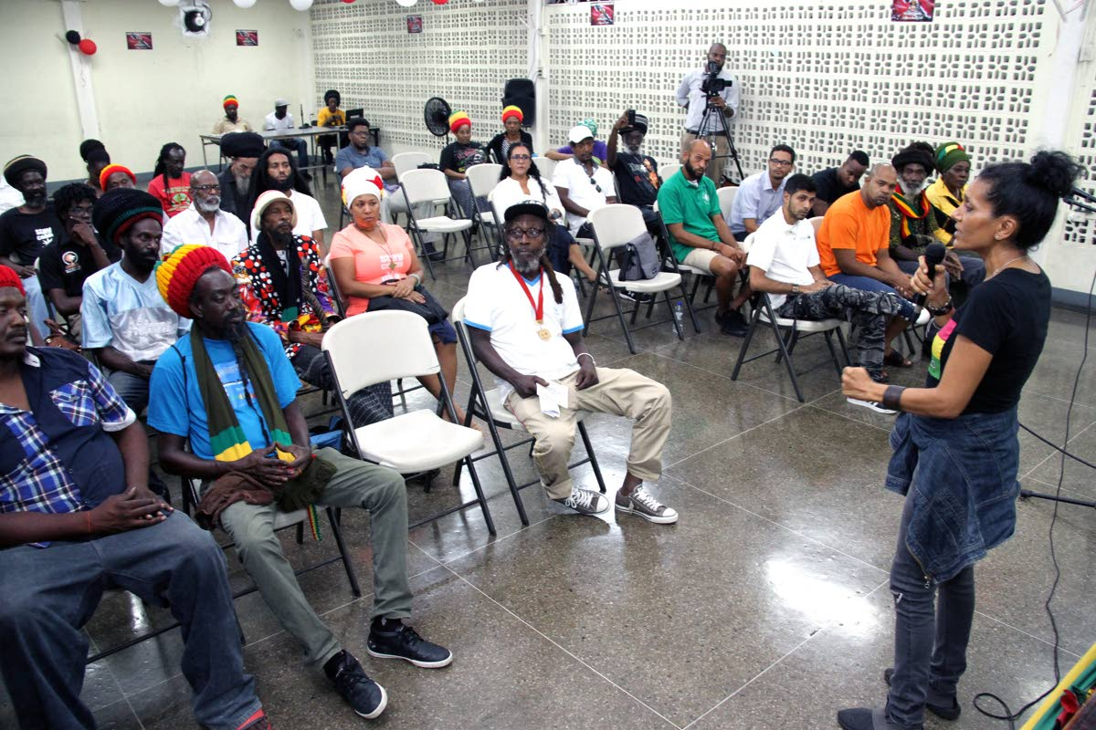 FIGHT THE POWER: Marijuana activist Nazma Muller speaks during a symposium on the legalisation of marijuana held on Thursday night at the Communication Workers Union headquarters, Henry Street, Port of Spain.