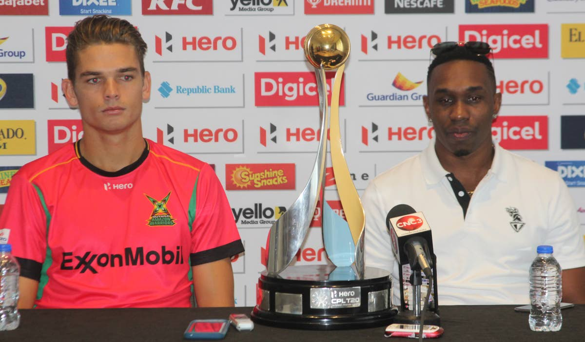 Trinbago Knight Riders'  captain Dwayne Brave (R) and Guyana Amazon Warriors' address the media, at the Hyatt Regency, Port of Spain, during a pre game press conference prior to today's Hero CPL T20 final between both teams, at the Brian Lara Cricket Academy, Tarouba.