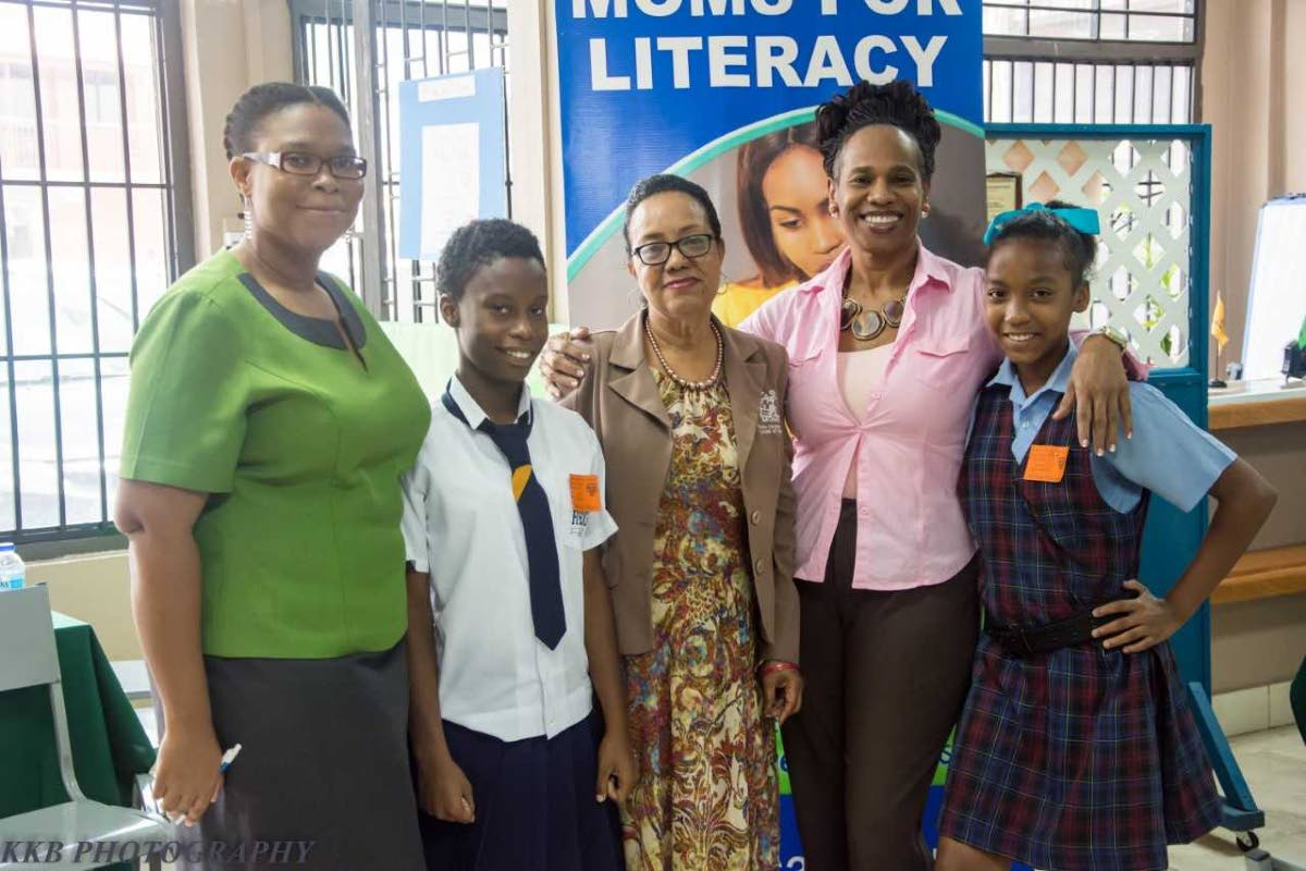 CREDO Foundation for Justice assistant co-ordinator  Calota Escovalez, left , Harmony Williams, founder of  Moms for Literacy, Amber Gonzales, Credo's programme co-ordinator Carlene Donald and   Karisha Williams at the award ceremony on September 14.