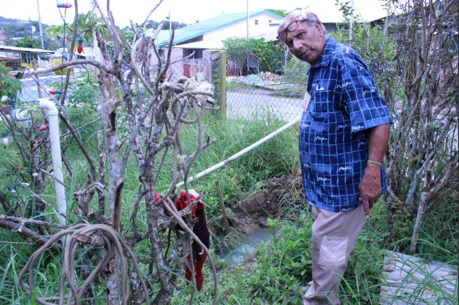 Balchan Sookdeo, 70, stands in his yard at Pleasantville.
