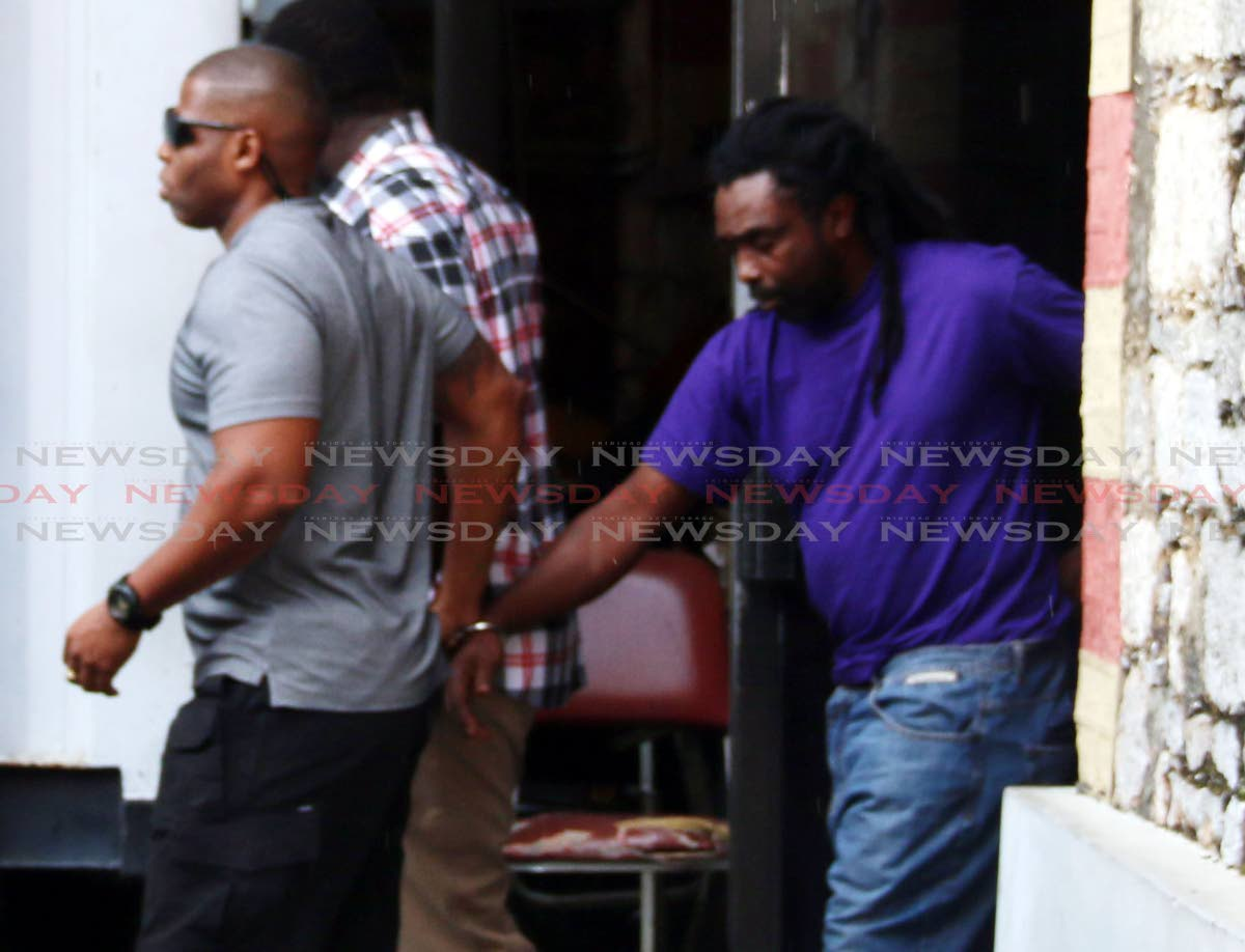 File photo: Gregory James (right) is escorted by PC George to the San Fernando High Court today to appear for the kidnapping of Natalie Pollonais PHOTO BY: ANSEL JEBODH