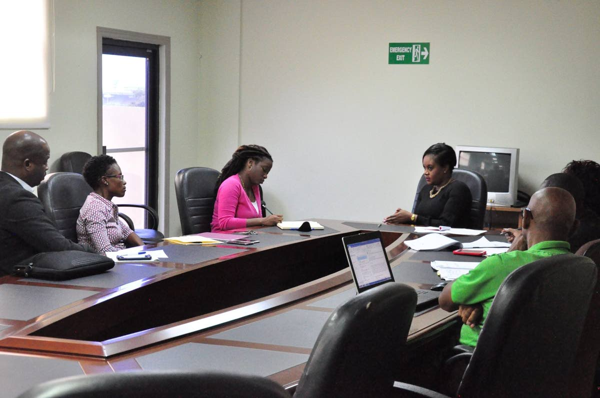 Jinelle James (second from left) and TTFA general secretary Justin Latapy-George during a meeting with Sports Minister Shamfa Cudjoe (centre) at the Ministry's office on Friday. PHOTO COURTESY MINISTRY OF SPORT AND YOUTH AFFAIRS.