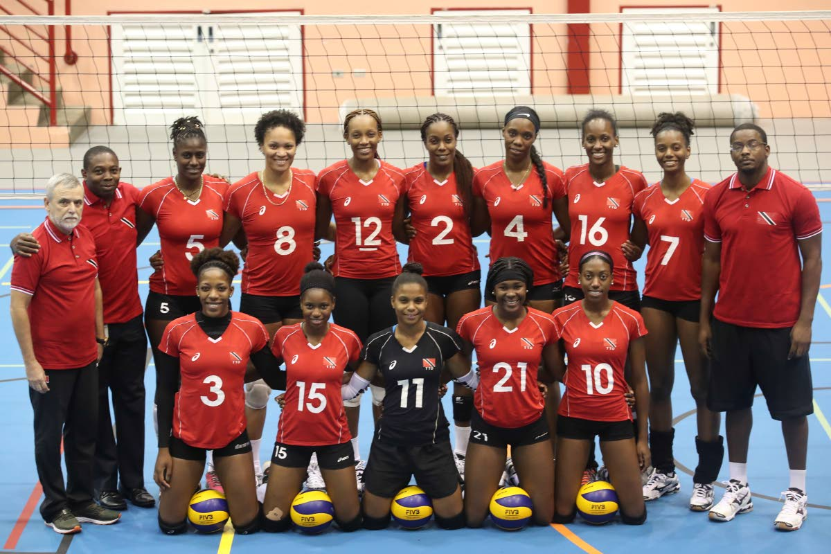 The Women's Senior National Volleyball team pose for photo prior to a final local scrimmage ahead of FIVB Women's Championships against UWI men's team at UWI SPEC, St. Augustine, yesterday. Photo: Allan V. Crane/CA-images