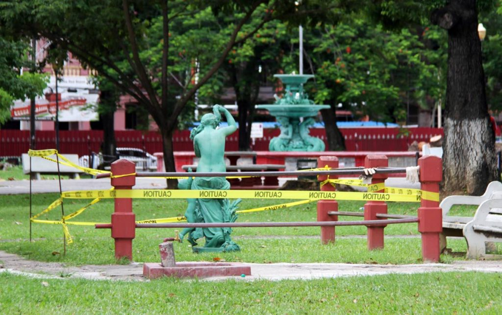 The 150-year-old statue of Aphrodite, the Greek Goddess of love, at the water fountain in Woodford Square, Port of Spain,  was taken down by city corporation workers for repair work. PHOTO SUREASH CHOLAI