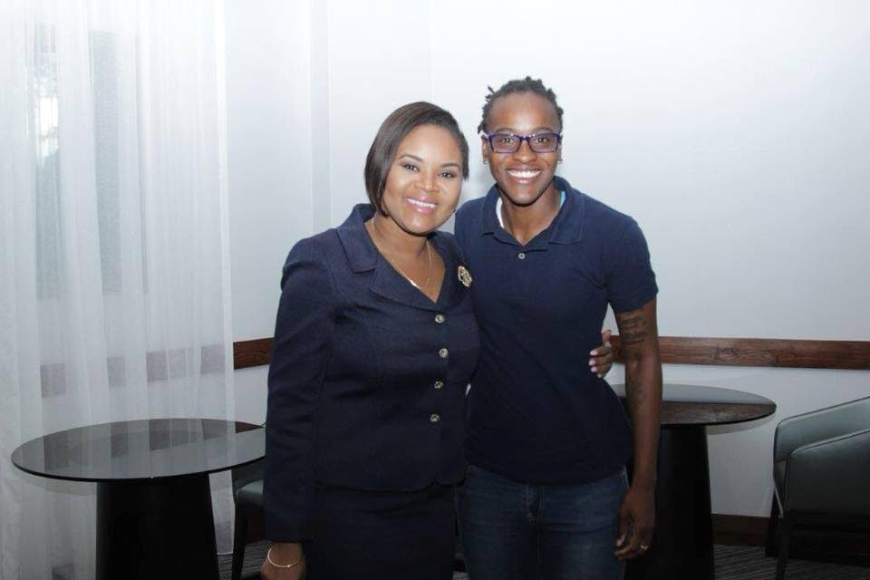 Shamfa Cudjoe, Minister of Sport and Youth Affairs (left) smiles after meeting national women's football team goalkeeper Kimika Forbes at the Ministry's office in St Clair on Tuesday.