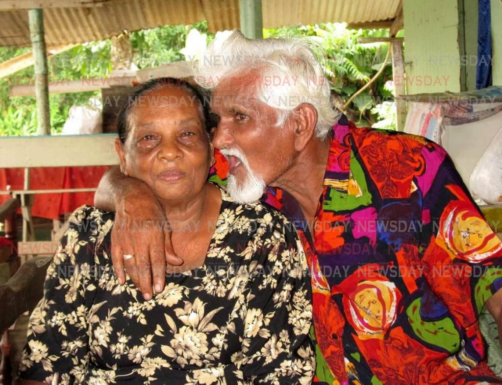 In happier times, at right, Dilip Singh, 79 and his wife Rosie, 78 of Suklal Trace, San Francique. Dilip was burnt to death and his wife Rosie, 78 warded at the San Fernando General Hospital after there home was destroyed by fire. RE COPY BY ANIL RAMPERSAD.