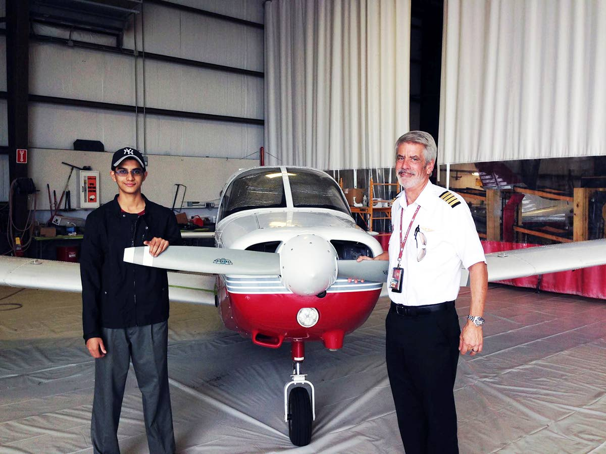 CHARGED: Trini-born aviation student Nishal Sankat is seen at left in this photo posted to his FB account, with an instructor at the Florida Institude of Technology. Sankat has been charged with attempting to steal an AA airbus.