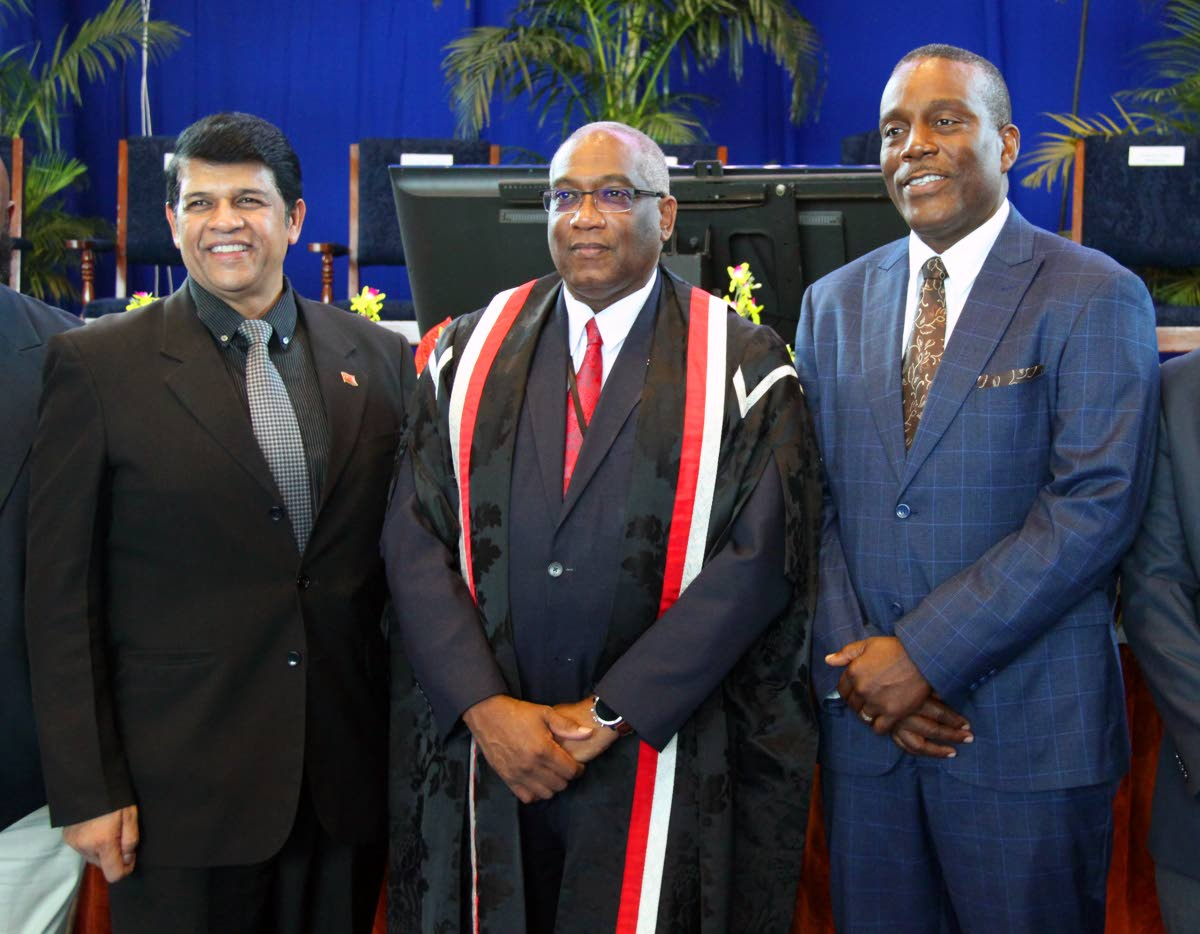 EDUCATED MEN: UWI St Augustine campus principal Prof Brian Copeland is flanked by St Augustine MP Prakash Ramadhar, left, and Tunapuna MP Esmond Forde at the UWI matriculation welcome ceremony Thursday evening at the campus. PHOTO BY SUREASH CHOLAI